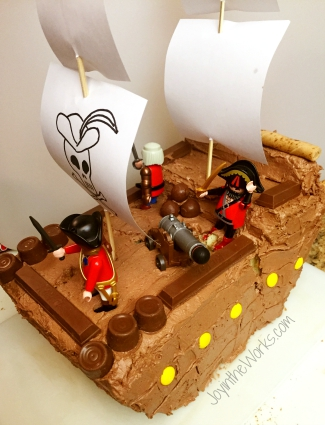 Pirate Ship Birthday Cake starts out with just a little crack that we thought we could hide with toothpicks and frosting