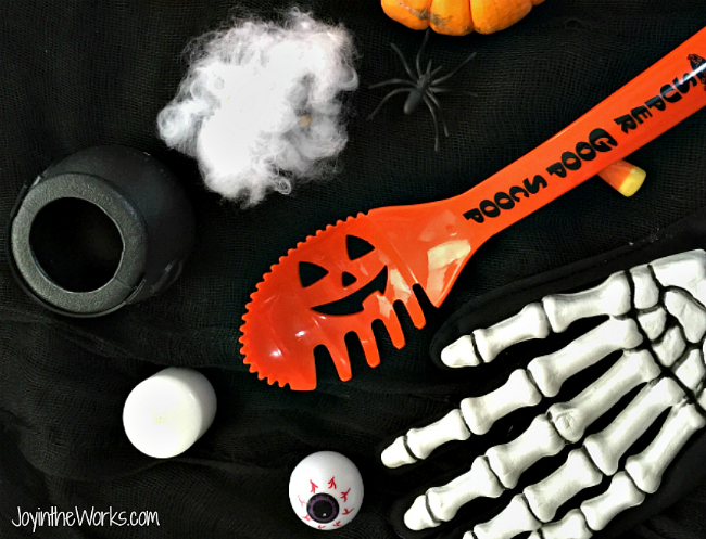 Play The What's Missing? Game Halloween version. Use a witch's hat for hiding the objects; from plastic eyeballs to mini pumpkins to skeleton hands!