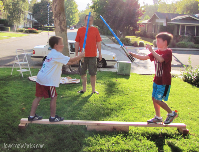 Light saber battles on a balance beam make a great Star Wars party game