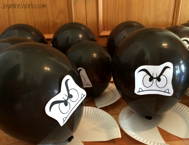 Stomp on goomba balloons for a Super Mario party game