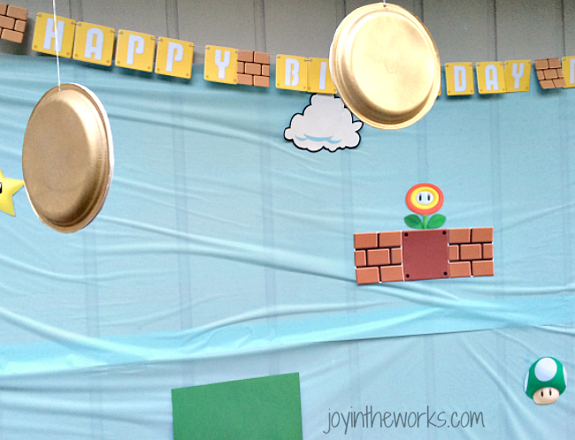 Find out how to make gold coins for the kids to jump up and hit for their Super Mario party game!