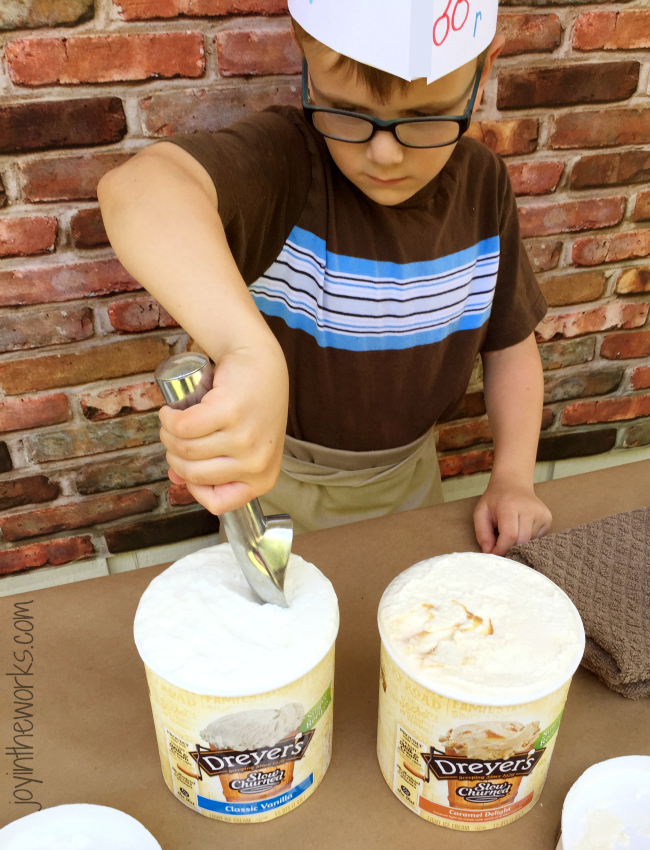 Scooping ice cream for the Ice Cream Shop while wearing his DIY Soda Jerk Hat #sweetertogether #ad
