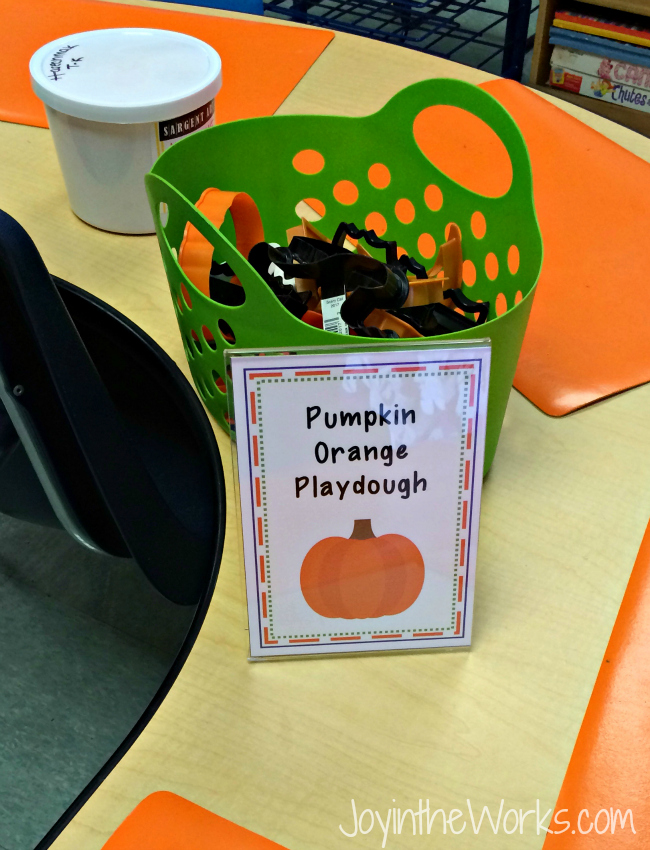 A simple, independent Halloween party activity: pumpkin orange playdough with Halloween cookie cutters