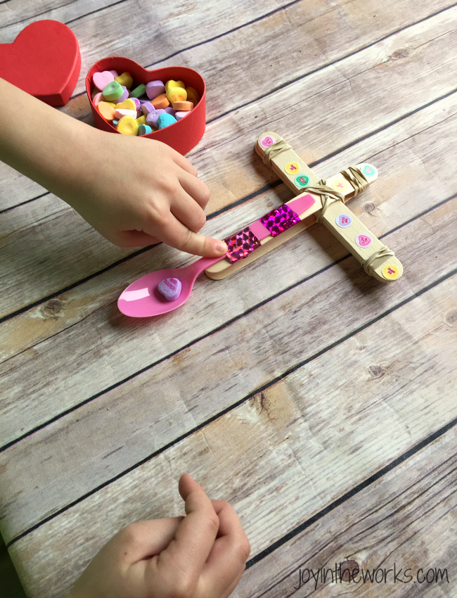 Looking for a fun activity for a class Valentine Party? Check out this Conversation Heart Valentine Catapult. It's a super easy #STEM activity for home or at school! Plus you can compare conversation hearts and other candy and eat the leftovers! =)