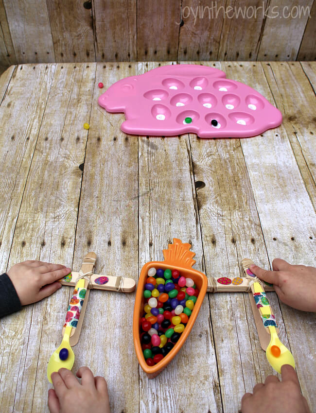 Looking for a fun Spring or Easter activity for an Easter Party or just a fun activity at home? Check out this Jelly Bean Catapult activity where the kids build their own catapults and launch the classic Easter candy! To make it extra fun, add point values and target practice! It's a great #STEM activity that ends with sweets!