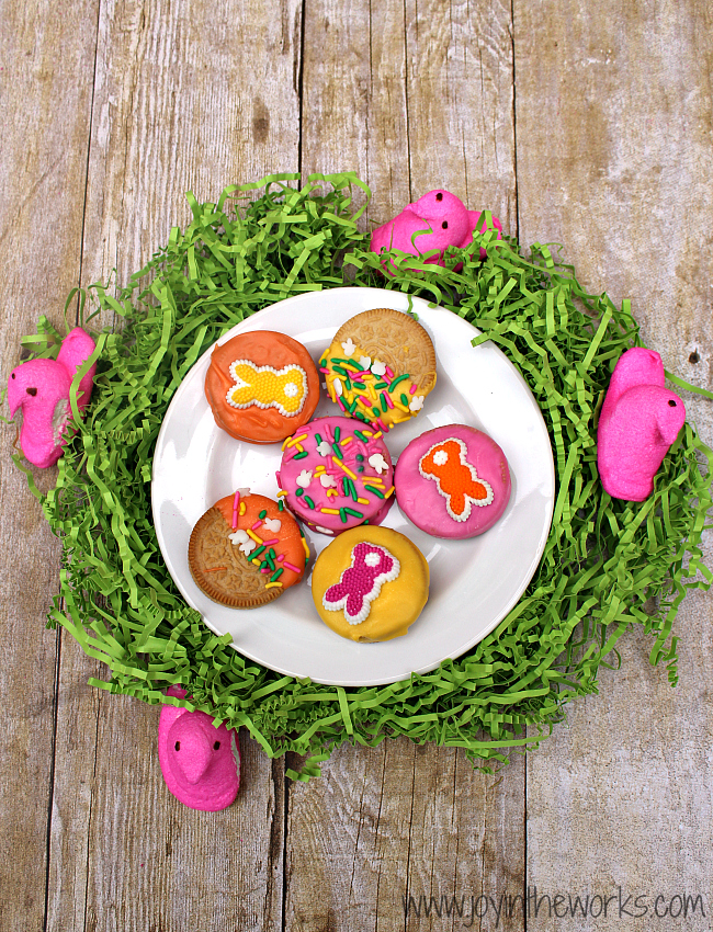 Did you know they make Peeps Oreos now?! I decided to make them even better by dipping them in candy and adding some festive Easter sprinkles! They were so fun to make and they tasted delicious too! A perfect Easter treat!