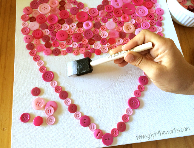 Looking for a kid made gift for Mother's Day or any other holiday? Check out this button heart that the kids made using buttons, glue and an art canvas