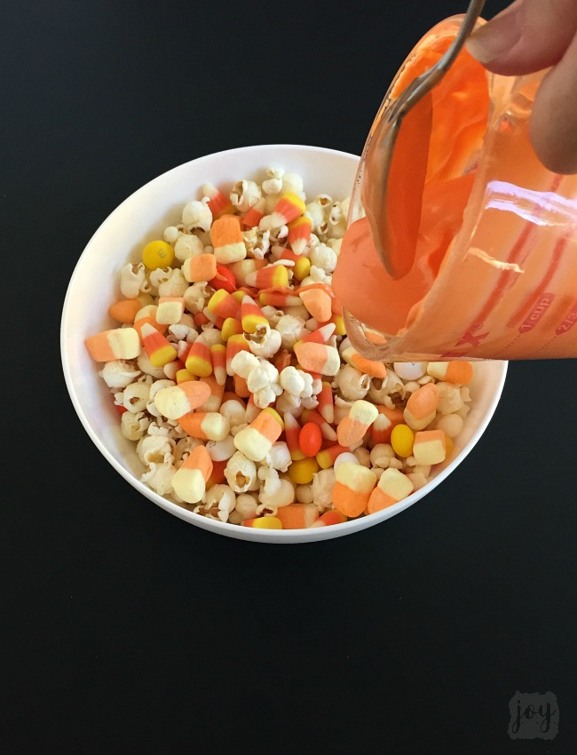 Whether you call it Candy Corn Trail Mix, Candy Corn Popcorn Mix or Candy Corn Snack Mix, this is the perfect Fall Snack for a Halloween Party or addition to a Boo Kit! Even better? It comes with a free printable Candy Corn Themed Halloween gift tag!