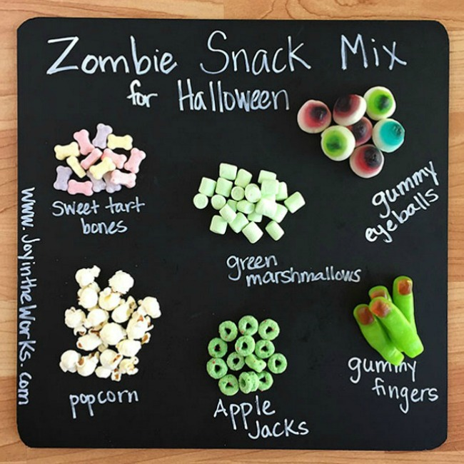 Throwing a Halloween party for kids? Looking for a creative Halloween themed snack? This Zombie Snack Mix for kids is the perfect Halloween party food with its gummy fingers, eyeballs and bones! For an extra special touch, add a green candy coating and green snack foods in green zombie cups for a true Zombie theme! #HalloweenPartyFood #ZombieSnackMix