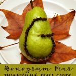 Beautiful kid made Thanksgiving Placecards! This Monogram Pear Thanksgiving Placecard made with cloves can be made by an adult or an older child and is such a beautiful addition to your Thanksgiving table! #thanksgivingtable #thanksgivingplacecards #diythanksgiving #thanksgivingcraft