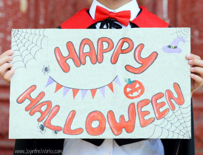 Have kids make signs and decorate posters for their Virtual Halloween Party video calls!